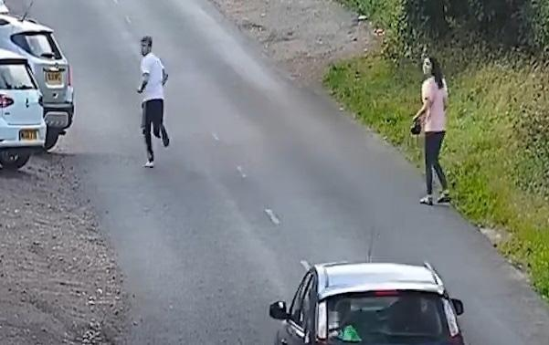 A second male, left, is then seen running from where the Renault crashed