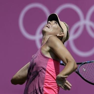 Maria Sharapova, of Russia, practices at the All England Lawn Tennis Club at Wimbledon, in London, at the 2012 Summer Olympics, Thursday, July 26, 2012. Tennis competition is scheduled to begin Saturday, July 28. (AP Photo/Mark Humphrey)