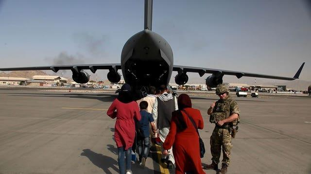 Captain Muraal at Kabul airport as she boards a British military plane to be evacuated to the UK from Afghanistan