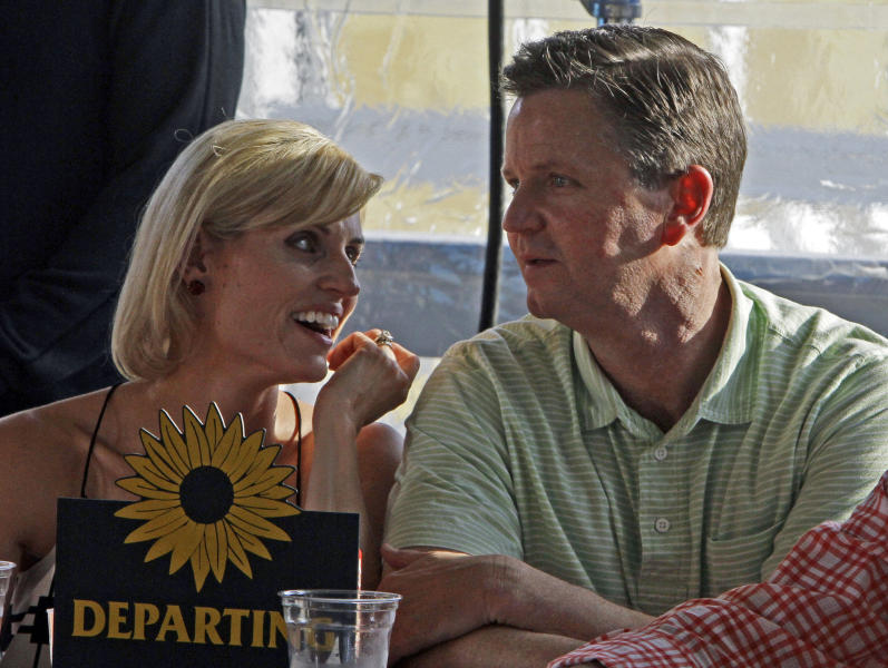 Trainer Al Stall Jr., right, talks with his wife Nicole, left, as they wait for the Preakness Stakes post position draw at Pimlico Race Course in Baltimore, Wednesday, May 15, 2013. Stall's Illinois Derby winner, Departing, will break from post position No. 4 in Saturday's race. (AP Photo/Garry Jones)