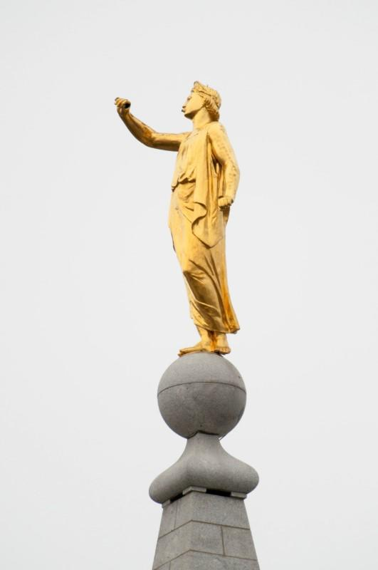 The Angel Moroni statue's outstretched hand appears empty after the trumpet toppled during a 5.7 magnitutude earthquake in Salt Lake City