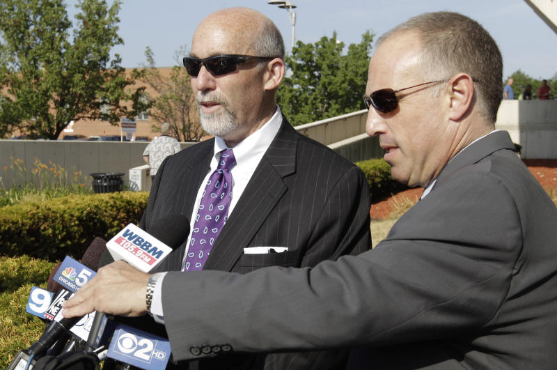 Former Bolingbrook police officer Drew Peterson's attorney Joel Brodsky, left, speaks to reporters accompanied by attorney Steve Greenburg before going into court for the first day of jury selection in Peterson's murder trial, Monday, July 23, 2012, in Joliet, Ill. Peterson, 58, is charged with killing his third wife, Kathleen Savio, in 2004. Her body was found in a dry bathtub in her home, her hair soaked with blood. The ex-Bolingbrook police sergeant is also a suspect in the 2007 disappearance of his fourth wife, Stacy Peterson. (AP Photo/M. Spencer Green)