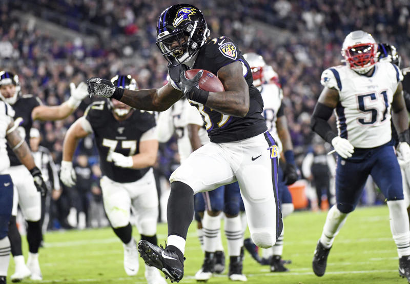 Baltimore Ravens running back Gus Edwards (35) runs for a 12-yard touchdown in the second quarter against the New England Patriots. (Getty Images)