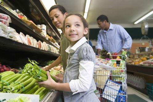 """<span class=""""caption"""">A good diet is key for a child's well-being.</span> <span class=""""attribution""""><a class=""""link rapid-noclick-resp"""" href=""""https://www.shutterstock.com/image-photo/man-shopping-son-daughter-supermarket-149629991?src=Oy4Q4lWu1Gp9R3zioJoNvw-1-9"""" rel=""""nofollow noopener"""" target=""""_blank"""" data-ylk=""""slk:Shutterstock"""">Shutterstock</a></span>"""