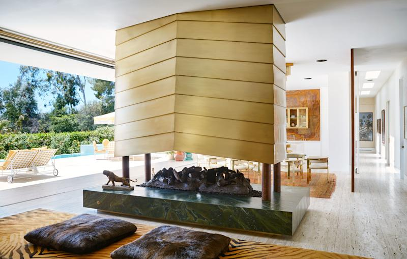 The bronze, dual-sided fireplace in the living and dining room is a custom design.