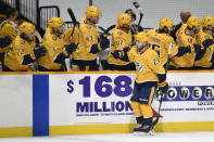 Nashville Predators right wing Rocco Grimaldi (23) is congratulated after scoring a goal against the Carolina Hurricanes during the first period of an NHL hockey game Monday, May 10, 2021, in Nashville, Tenn. (AP Photo/Mark Zaleski)