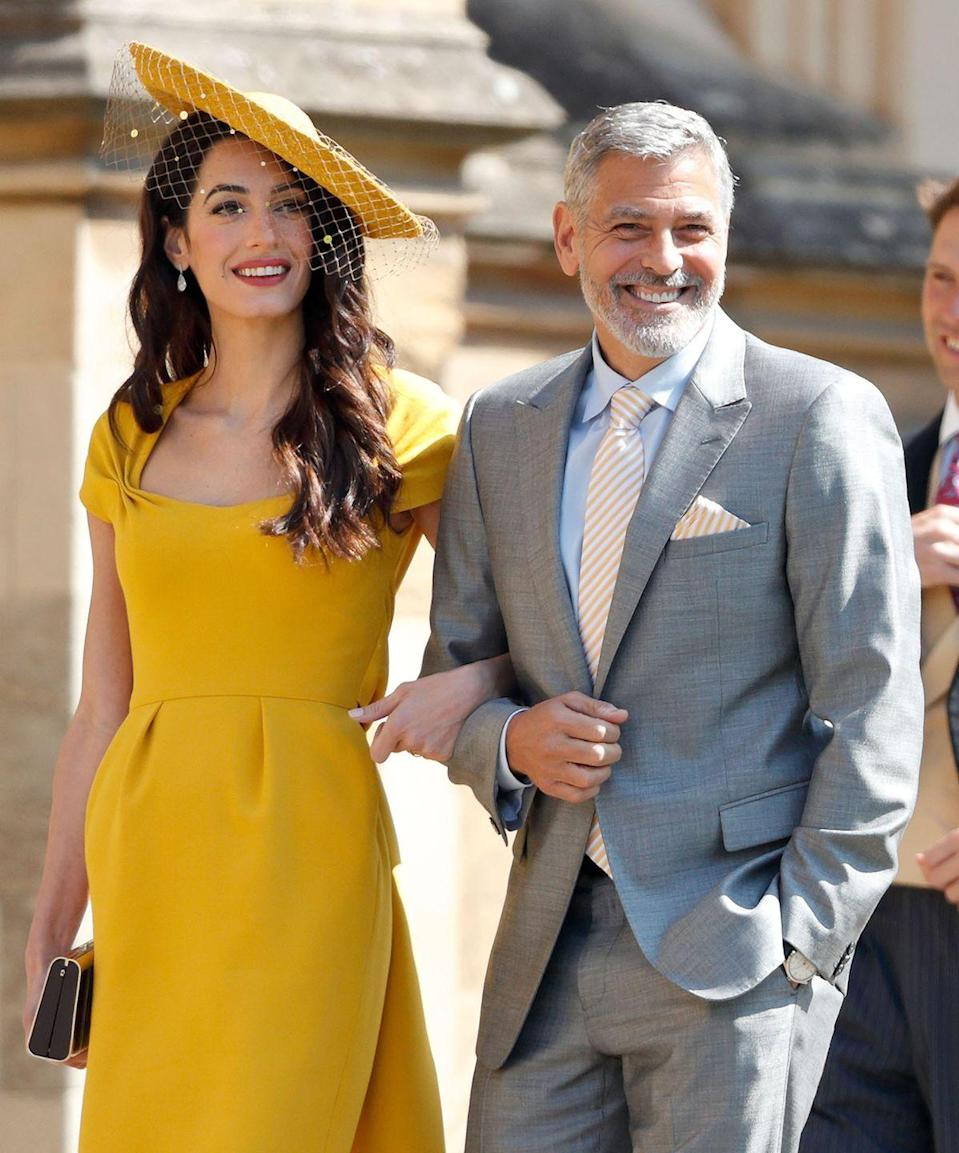 <p>Amal Clooney and Clooney attend the wedding of Prince Harry to Meghan Markle at St George's Chapel, Windsor Castle on May 19, 2018 in Windsor, England.</p>