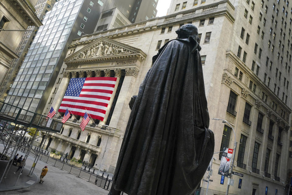 Photo by: John Nacion/STAR MAX/IPx 2020 11/10/20 Atmosphere in and around Wall Street and The New York Stock Exchange in the Financial District of Lower Manhattan, New York City on November 10, 2020. The U.S. stock market experienced a day of volatile trading on Monday, November 9, 2020 as Wall Street investors considered the Pfizer Inc. announcement of a COVID-19 vaccine along with the recent presidential election results. Some investment brokers including Fidelity, TD Ameritrade, Charles Schwab and Vanguard reported technical problems - though all reported the issues were resolved within several hours. Some attributed the problems to heavy activity early in the trading day. Here, a view of the statue of George Washington at Federal Hall facing the New York Stock Exchange. (NYC)