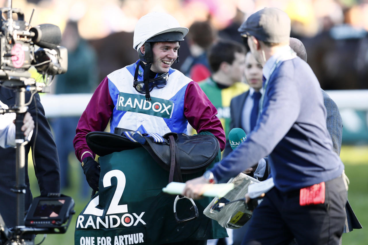 Britain Horse Racing - Grand National Festival - Aintree Racecourse - 8/4/17 Derek Fox  celebrates winning after after riding One For Arthur to victory in the 5:15 Randox Health Grand National Action Images via Reuters / Jason Cairnduff Livepic
