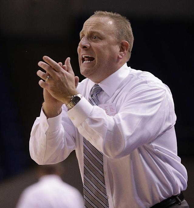 In this Nov. 6, 2013 photo, San Jose State coach Dave Wojcik gestures during a basketball game against Pacific, in San Jose, Calif. Wojcik has made so many stops criss-crossing the country for work he began to wonder if he would ever get to be a head coach. On Tuesday night, Nov. 12, 2013, he makes his debut at last when his San Jose State team opens the season at Santa Clara. (AP Photo/Ben Margot)