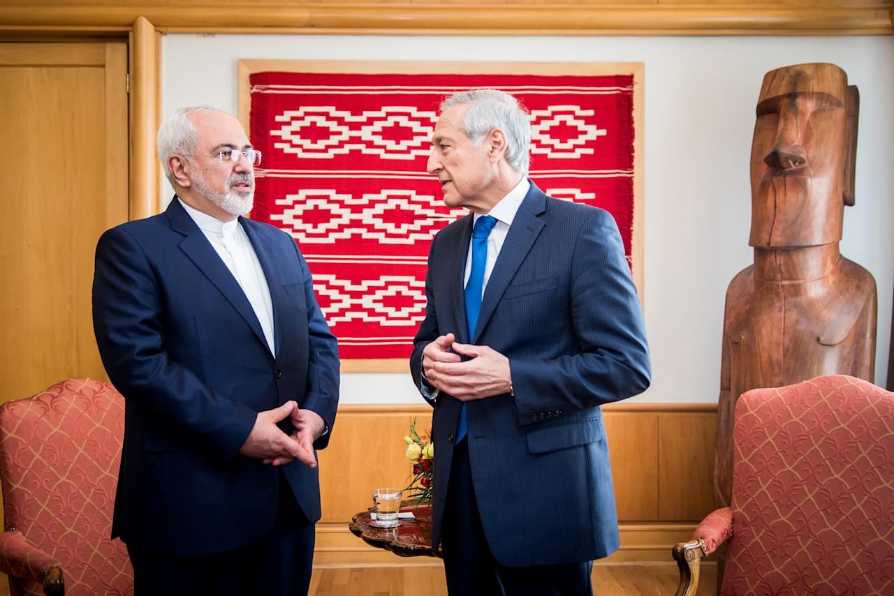 Iranian Foreign Minister Mohammad Javad Zarif (L) talks with his Chilean counterpart Heraldo Munoz of Chile during a meeting at the Ministry of Foreign Affairs in Santiago, Chile, August 25, 2016. Viviana Urra/Courtesy of Chilean Ministry of Foreign Affairs/Handout via Reuters ATTENTION EDITORS - THIS IMAGE WAS PROVIDED BY A THIRD PARTY. EDITORIAL USE ONLY.