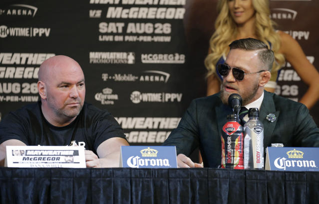 Dana White (L) continues to support lightweight champ Conor McGregor, despite his absence in the cage. (AP)