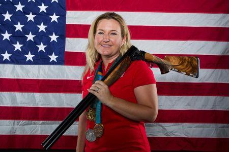 Shooting athlete Kim Rhode poses for a portrait during the 2012 U.S. Olympic Team Media Summit in Dallas, Texas May 14, 2012.  REUTERS/Lucas Jackson/File Photo