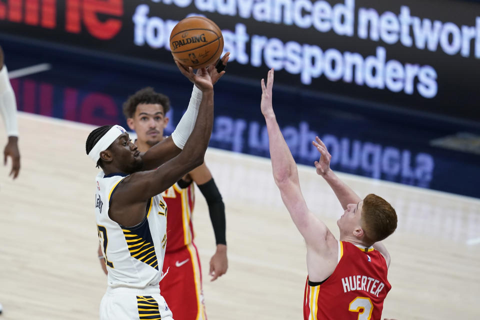 Indiana Pacers' Caris LeVert (22) shoots over Atlanta Hawks' Kevin Huerter (3) during the second half of an NBA basketball game Thursday, May 6, 2021, in Indianapolis. (AP Photo/Darron Cummings)