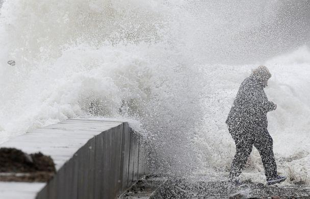 PHOTO: A woman gets caught by a wave as heavy seas continue to come ashore in Wintrhrop, Mass., March 3, 2018. (Michael Dwyer/AP, FILE)