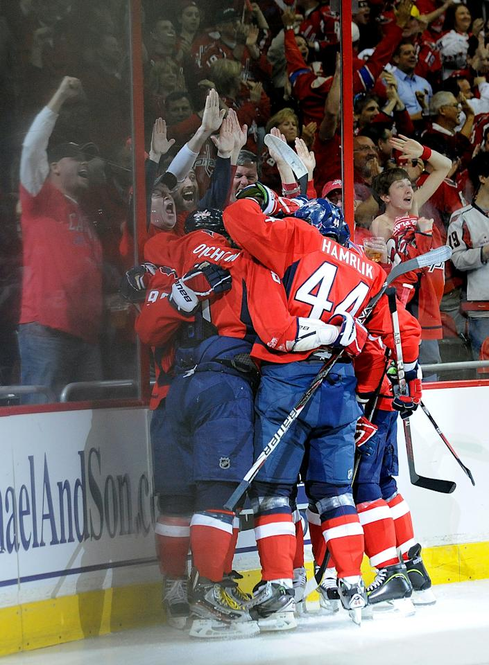 WASHINGTON, DC - APRIL 19:  Marcus Johansson #90 of the Washington Capitals celebrates with his teammates after scoring a goal against the Boston Bruins in Game Four of the Eastern Conference Quarterfinals during the 2012 NHL Stanley Cup Playoffs at Verizon Center on April 19, 2012 in Washington, DC.  (Photo by Patrick McDermott/Getty Images)