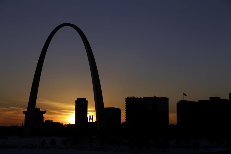 FILE -- In this Jan. 7, 2014 file photo the Gateway Arch dominates the skyline in St. Louis. The iconic Arch, built as a monument to westward expansion, stands 630 feet tall along the banks of the Mississippi River. For a fee, visitors can ride a tram to the top of the Arch and gaze over downtown St. Louis to the west or the cornfields of Illinois to the east, but many attractions at and around the Arch are free. (AP Photo/Jeff Roberson, File)