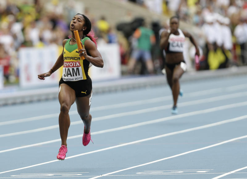 Jamaica's Shelly-Ann Fraser-Pryce crosses the finish line to win the women's 4x100-meter relay final at the World Athletics Championships in the Luzhniki stadium in Moscow, Russia, Sunday, Aug. 18, 2013. (AP Photo/Anja Niedringhaus)