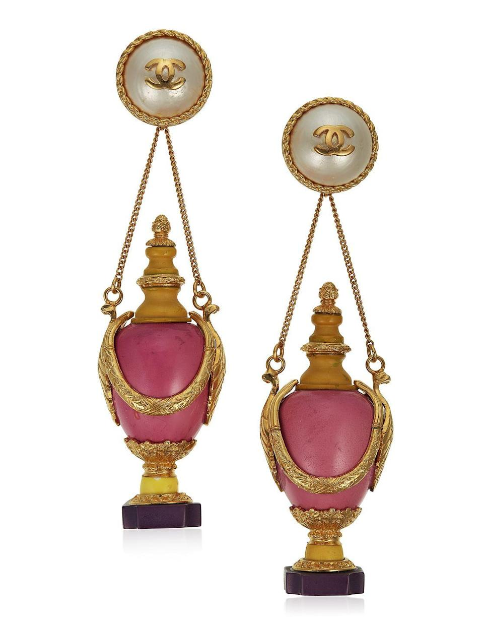 <p>These unsigned, oversize faux pearl and resin earrings featuring dangling urns are estimated to be worth $3,000 to $5,000. </p>