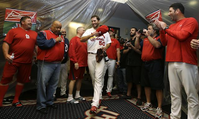 St. Louis Cardinals pitcher Adam Wainwright (50) enters the locker room after the Cardinals defeated the Pittsburgh Pirates 6-1 in Game 5 of a National League baseball division series, Wednesday, Oct. 9, 2013, in St. Louis. The Cardinals advanced to the NL championship series against the Los Angeles Dodgers. (AP Photo/Jeff Roberson)