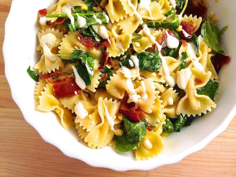 """<p>A bowtie pasta salad loaded with ingredients no one can resist.</p><p>Get the recipe from <a href=""""https://www.redbookmag.com/cooking/recipe-ideas/recipes/a43135/bacon-corn-spinach-and-ranch-pasta-salad-recipe/"""" rel=""""nofollow noopener"""" target=""""_blank"""" data-ylk=""""slk:Delish"""" class=""""link rapid-noclick-resp"""">Delish</a>.</p>"""