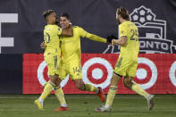 Nashville SC's Daniel Ros, center, celebrates his overtime goal with Hany Mukhtar, left, and Walker Zimmerman during the team's MLS soccer playoff match against Toronto FC, Tuesday, Nov. 24, 2020, in East Hartford, Conn. (AP Photo/Jessica Hill)