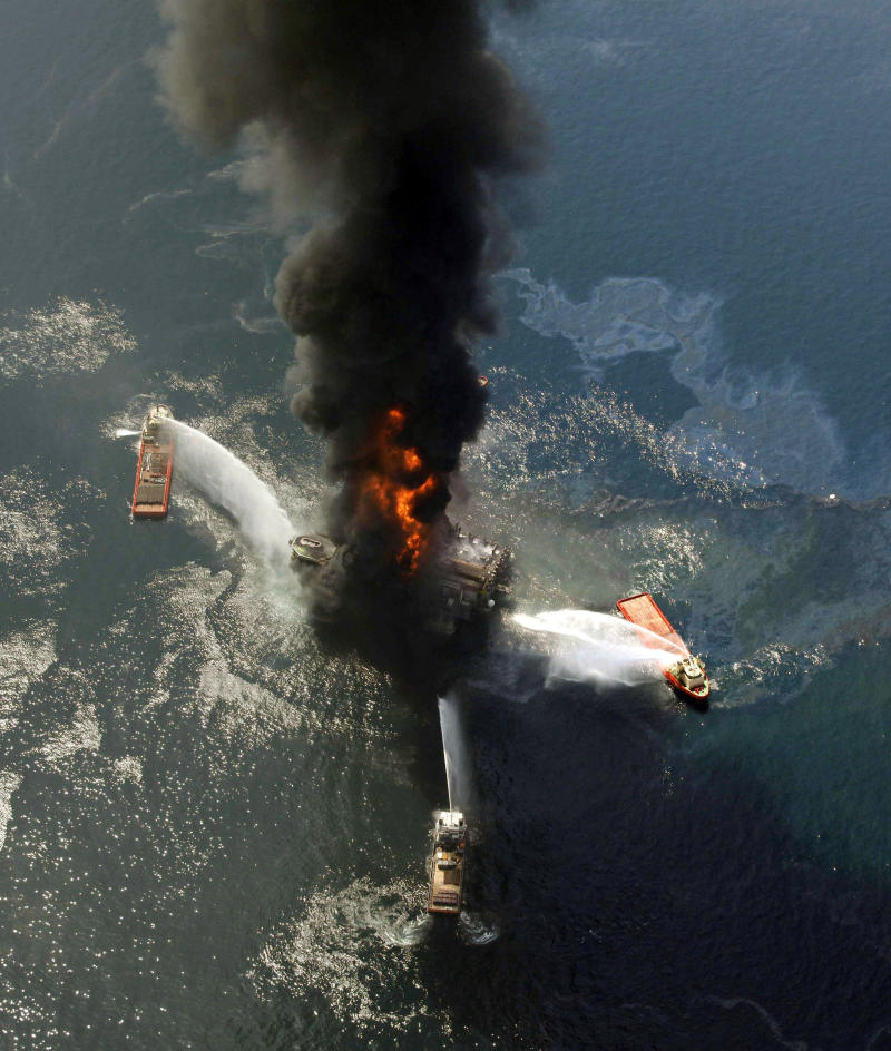 FILE - This April 21, 2010, file photo show the Deepwater Horizon oil rig burning after an explosion in the Gulf of Mexico, off the southeast tip of Louisiana. BP, the oil giant at the center of one of the world's biggest environmental crises, is making strong profits again, its stock has largely rebounded, and it is paying dividends to shareholders once more. It is also pursuing new ventures from the Arctic to India. It is even angling to explore again in the deep waters of the Gulf of Mexico, where it holds more leases than any competitor. (AP Photo/Gerald Herbert, File)