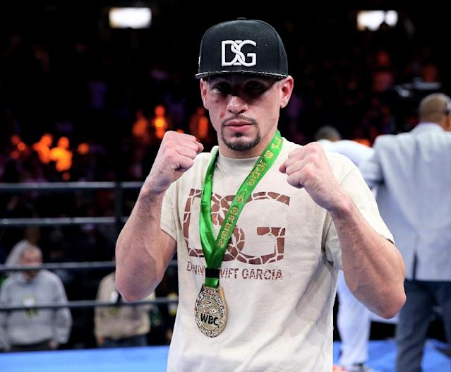 Danny Garcia poses after defeating Lamont Peterson in their Premier Boxing Champions Middleweight bout, at Barclays Center in New York, in April 2015 (AFP Photo/Elsa)