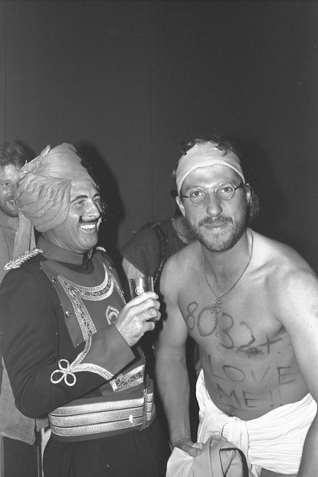 Dec 1981:  Geoff Boycott and Ian Botham (right) share a joke at the England fancy dress party in Delhi where Botham had come dressed as Boycott.  Boycott had just passed the record for most test runs scored.  Mandatory Credit:  Adrian Murrell/Allsport UK