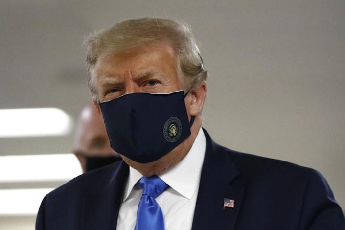 """President Trump wears a face mask Saturday at Walter Reed National Military Medical Center in Bethesda, Md. <span class=""""copyright"""">(Patrick Semansky / Associated Press)</span>"""