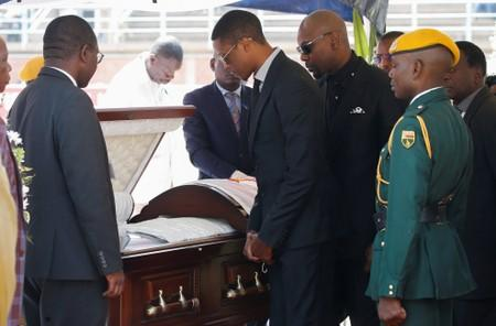 Robert Mugabe Jnr, pays his last respects to his father, Robert Mugabe as his body lies in state at the at Rufaro stadium