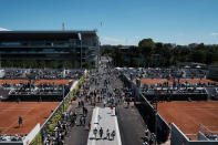 Visitors stroll in the alleys of the Roland Garros stadium during the French Open tennis tournament, Sunday, May 30, 2021 in Paris. (AP Photo/Thibault Camus)