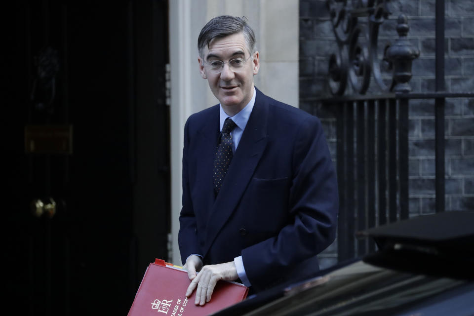 Britain's Leader of the House of Commons Jacob Rees-Mogg arrives for a cabinet meeting in Downing Street in London, Tuesday, Oct. 22, 2019. British Prime Minister Boris Johnson's European Union divorce bill faces two votes Tuesday, with lawmakers first being asked to approve it in principle, followed by a vote on the government's schedule for debate and possible amendments. (AP Photo/Matt Dunham)