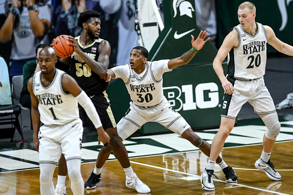 Michigan State's Marcus Bingham Jr., right, guards Purdue's Trevion Williams during the first half on Friday, Jan. 8, 2021, at the Breslin Center in East Lansing.