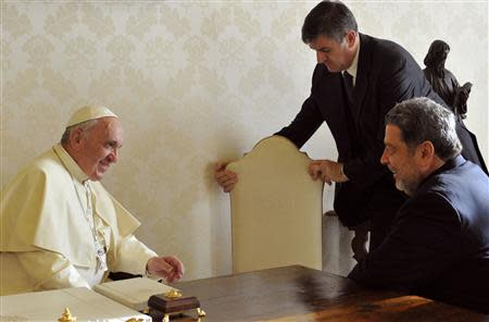 Pope Francis (L) talks to Saint Vincent and the Grenadines' Prime Minister Ralph Gonsalves (R) during a private audience at the Vatican December 19, 2013. REUTERS/Tiziana Fabi/Pool