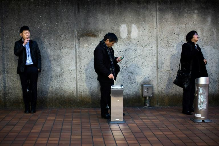 More than 240 Japanese municipalities restrict lighting up on city streets, meaning smokers must get their fix in clearly marked smoking zones
