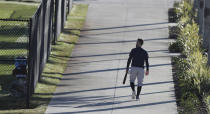 Atlanta Braves outfielder Ender Inciarte heads out for some early morning batting practice during baseball spring training at CoolToday Park in North Port, Fla., on Thursday, Feb. 25, 2021. (Curtis Compton/Atlanta Journal-Constitution via AP)