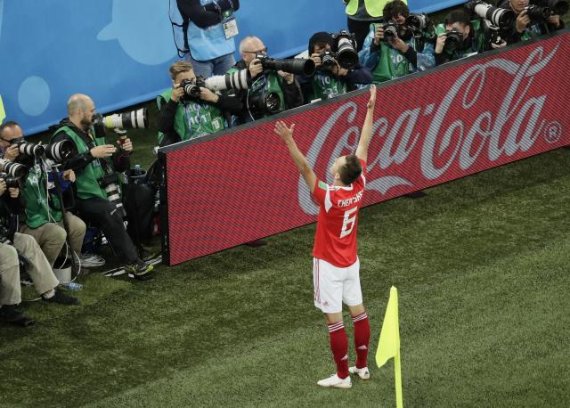 Russia's Denis Cheryshev celebrates after scoring his side's second goal against Egypt during the group A match between Russia and Egypt at the 2018 soccer World Cup in the St. Petersburg stadium in St. Petersburg, Russia, Tuesday, June 19, 2018. (AP Photo/Dmitri Lovetsky)