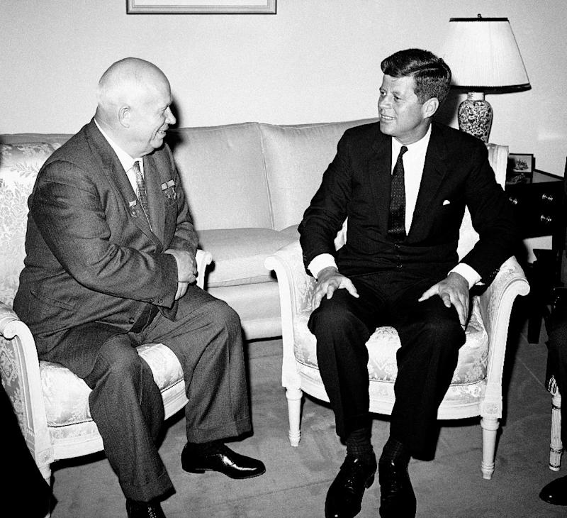 """FILE - In this June 3, 1961, file photo, Soviet Premier Nikita Khrushchev and President John F. Kennedy talk in the residence of the U.S. Ambassador in a suburb of Vienna. The meeting was part of  a series of talks during their summit meetings in Vienna. Fifty years after the Cuban missile crisis, the National Archives in Washington has pulled together documents and secret White House recordings to show the public how President John F. Kennedy deliberated to avert nuclear war. The exhibit opens Friday, Oct. 12, 2012, to recount the showdown with the Soviet Union. It is called """"To the Brink: JFK and the Cuban Missile Crisis."""" (AP Photo)"""