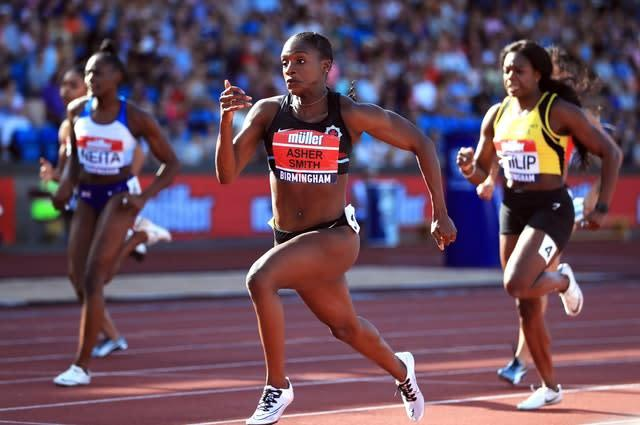 Dina Asher-Smith, centre, was victorious in Birmingham (PA)