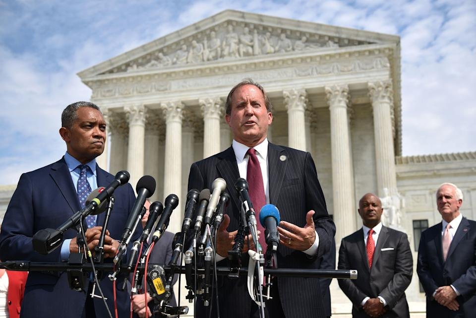 """Texas Attorney General Ken Paxton (center) traveled to Utah last week during the winter storms that claimed dozens of lives and<a href=""""https://www.huffpost.com/entry/power-outages-texas-winter-snow_n_602d8719c5b673b19b65c341"""">knocked out power to millions</a> of residents. (Photo: MANDEL NGAN/AFP via Getty Images)"""