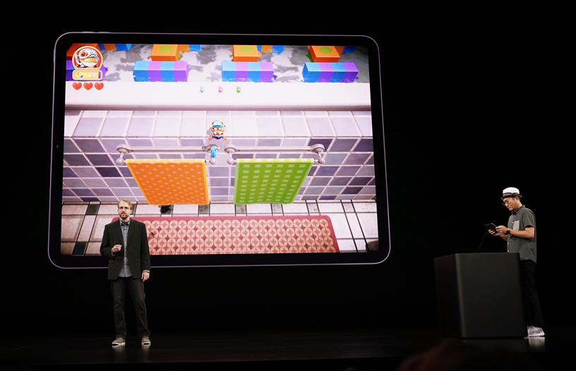 "Konami brand manager Benjamin Kinney demos ""Frogger in Toy Town,"" a reimagining of the classic game available only on Apple Arcade. Image: Apple"