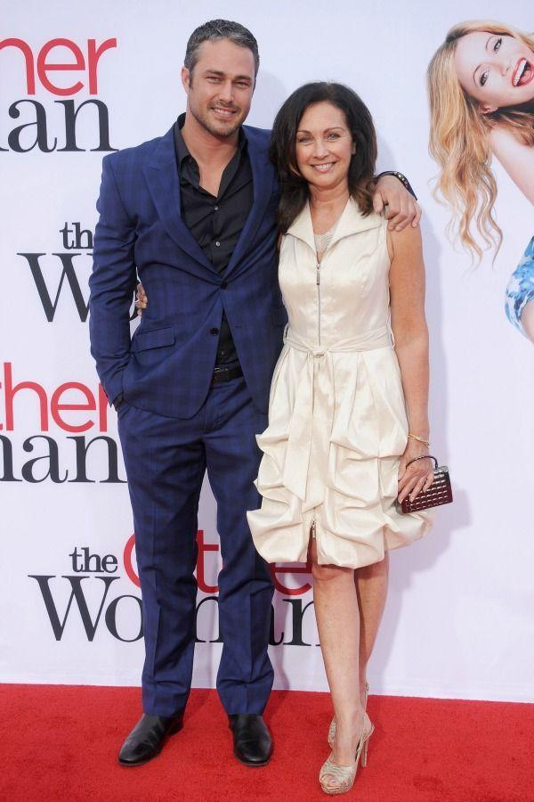 <p>Taylor's got his mom's back at 2014 <em>The Other Woman </em>premiere, and Pamela Heisler is clearly loving all her son's hard-earned success. </p>