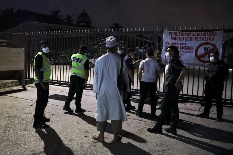 Malaysia expects coronavirus cases to spike as more worshippers traced