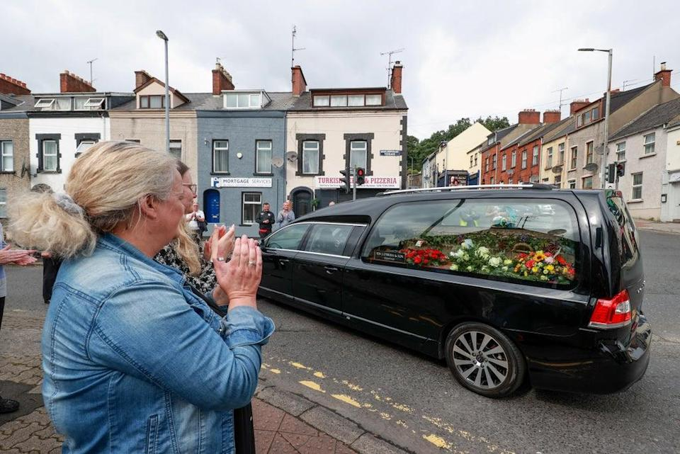 Applause as the funeral cortege of Pat Hume leaves St Eugene's Cathedral in Londonderry (Liam McBurney/PA) (PA Wire)
