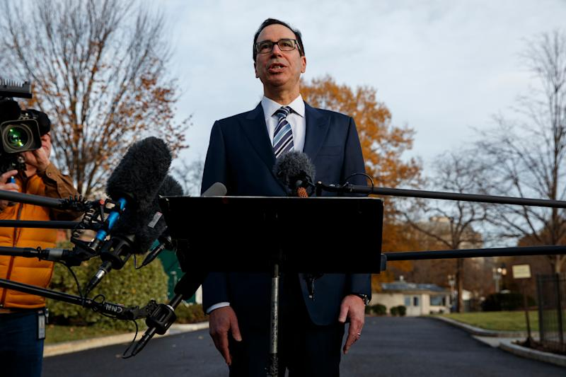 Treasury Secretary Steve Mnuchin talks with reporters about trade negotiations with China, at the White House, Monday, Dec. 3, 2018, in Washington. (AP Photo/Evan Vucci)