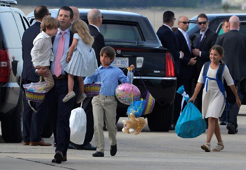 Donald Trump, Jr. carries two of his children as two others trail behind him as they disembark from Air Force One, after an Easter weekend with father President Donald Trump at the Mar-a-Lago estate in Florida, as they return to Joint Base Andrews, Maryland, in suburban Washington, U.S., April 16, 2017.           REUTERS/Mike Theiler