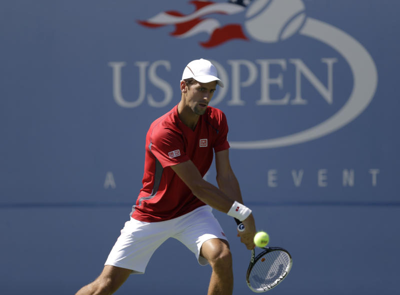 Serbia's Novak Djokovic practices a day before the US Open tennis tournament starts Sunday, Aug. 25, 2013, in New York. (AP Photo/Kathy Willens)