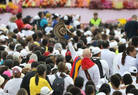 The faithful attend a mass led by Pope Francis (not pictured) at the Contecar harbour in Cartagena, Colombia September 10, 2017. REUTERS/Nacho Doce