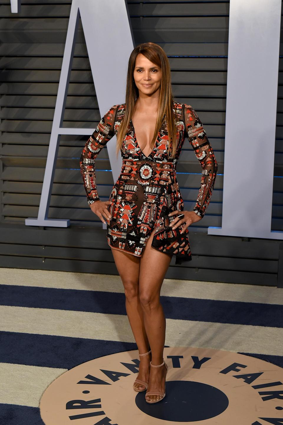 <p>Halle teamed a sleek and simple hairdo with her bold-printed mini for the Vanity Fair Oscars bash (Getty Images) </p>